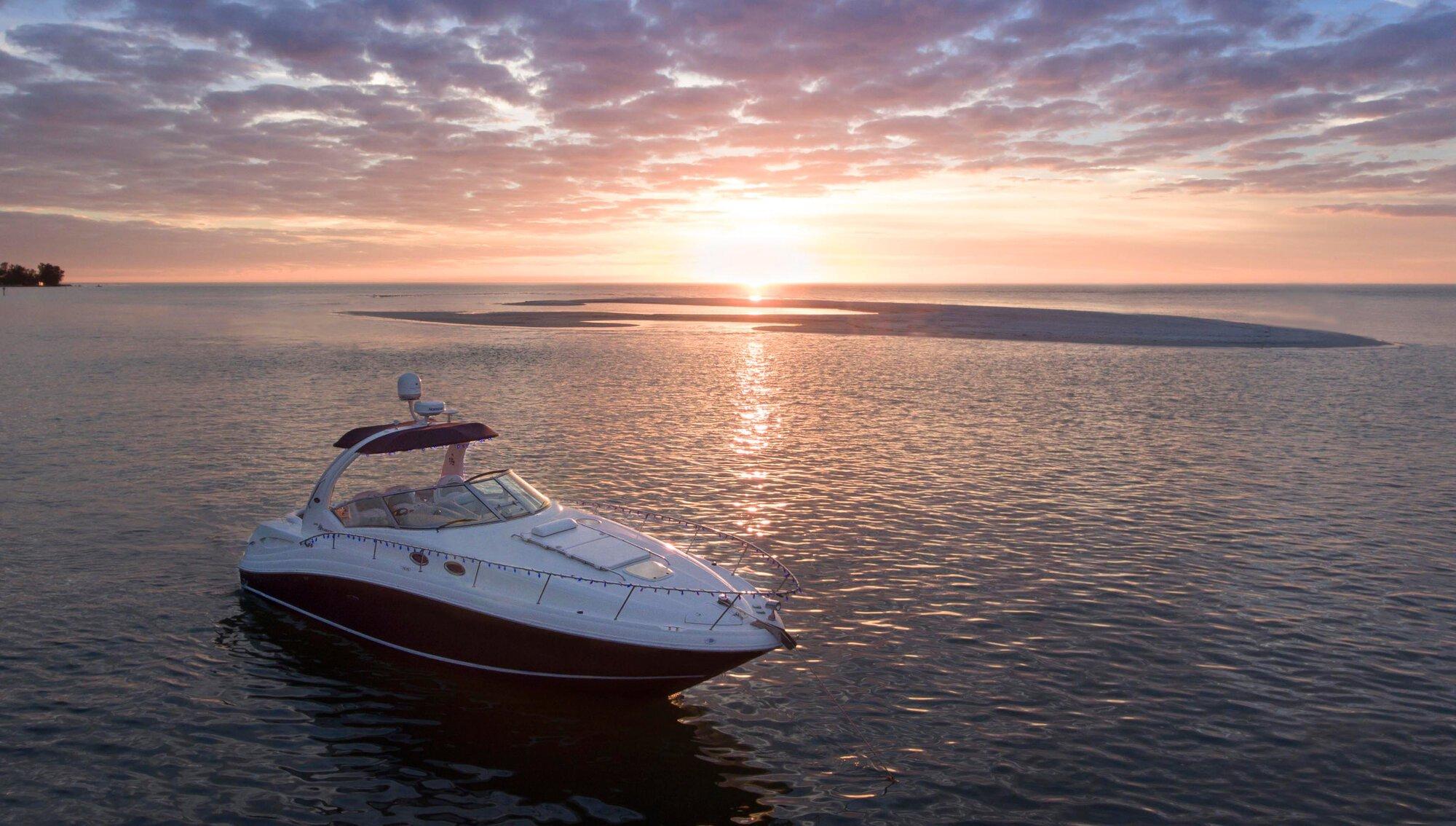 Luxury-boat-anchored-by-sandbar-sunset_SarasotaFlorida_1_2000x1134_etovilla