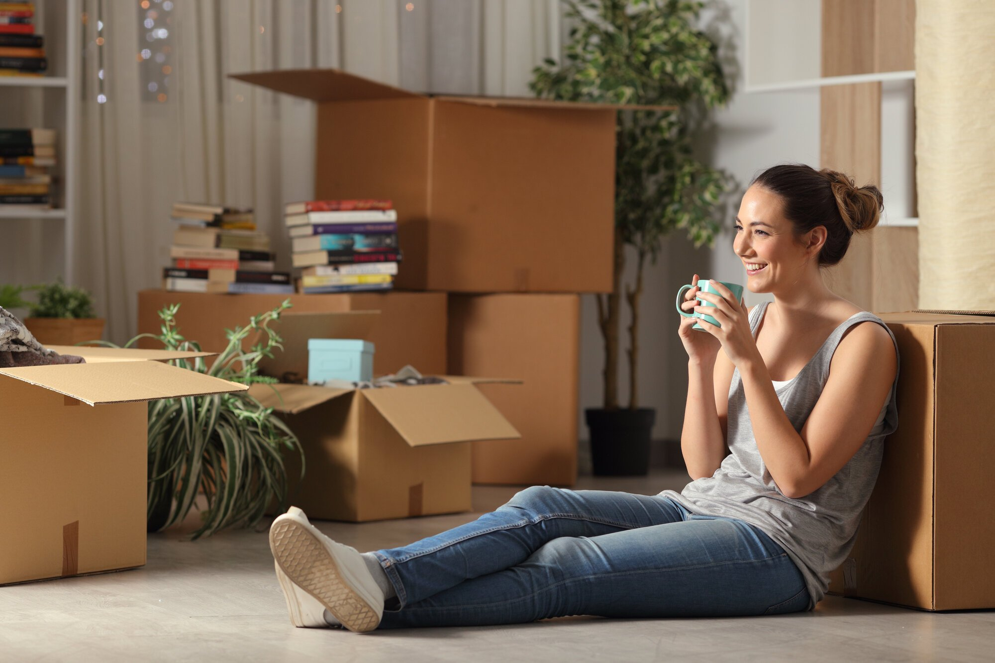 Happy,Tenant,Resting,Drinking,Coffee,Moving,Home,Sitting,On,The